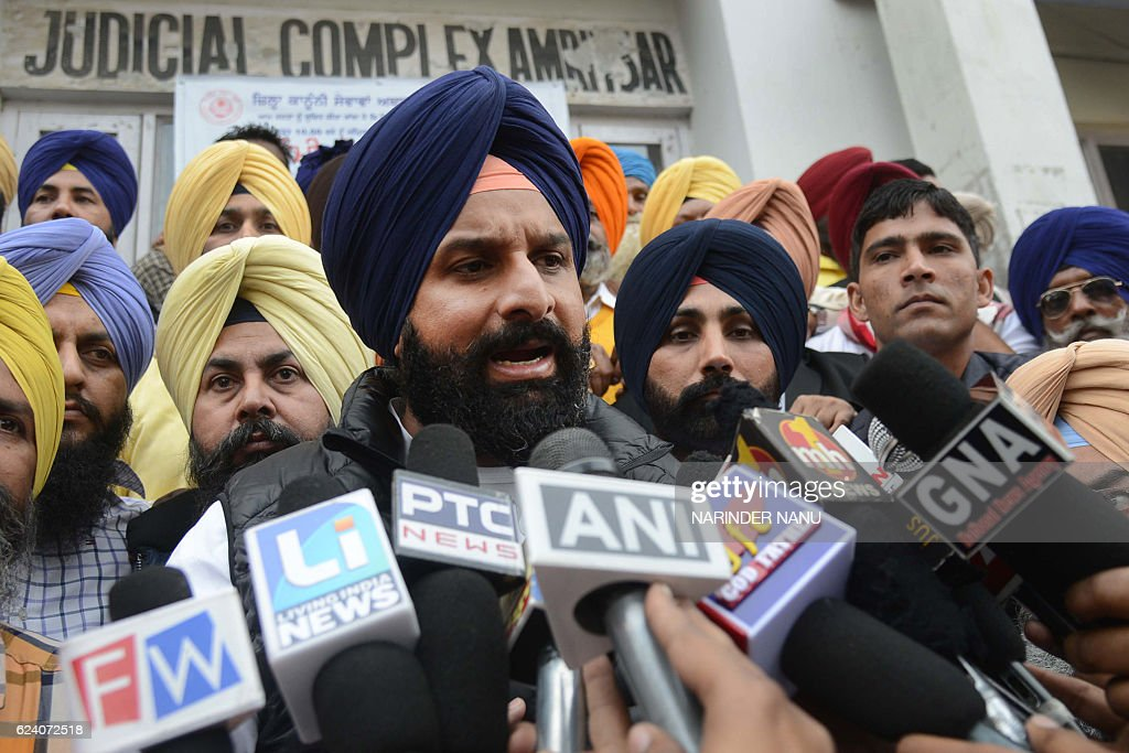 Indian Punjab Revenue Minister Bikram Singh Majithia leaves the court after attending a hearing of a defamation case against Delhi Chief Minister...