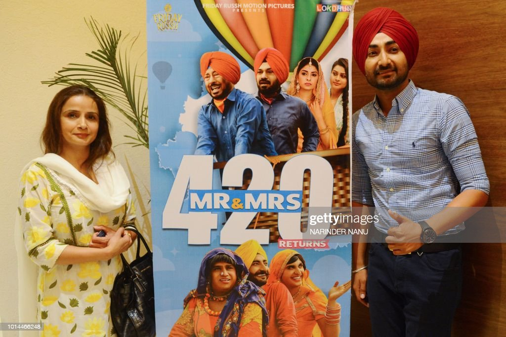 Indian Punjab singer and actor Ranjit Bawa and producer Rrupaali Gupta pose during a promotional event for the upcoming Punjabi film `Mr Mrs 420` at..