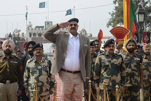 Indian Punjab state Governor VP Singh Badnore salutes a guard of honour on his arrival before flagging off a cycling expedition at the IndiaPakistan..