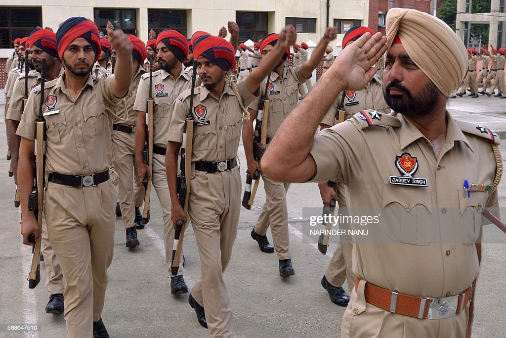 Indian Punjab state police personnel march past as they take part in a rehearsal for Independence Day Parade celebrations in Amritsar on August 12...