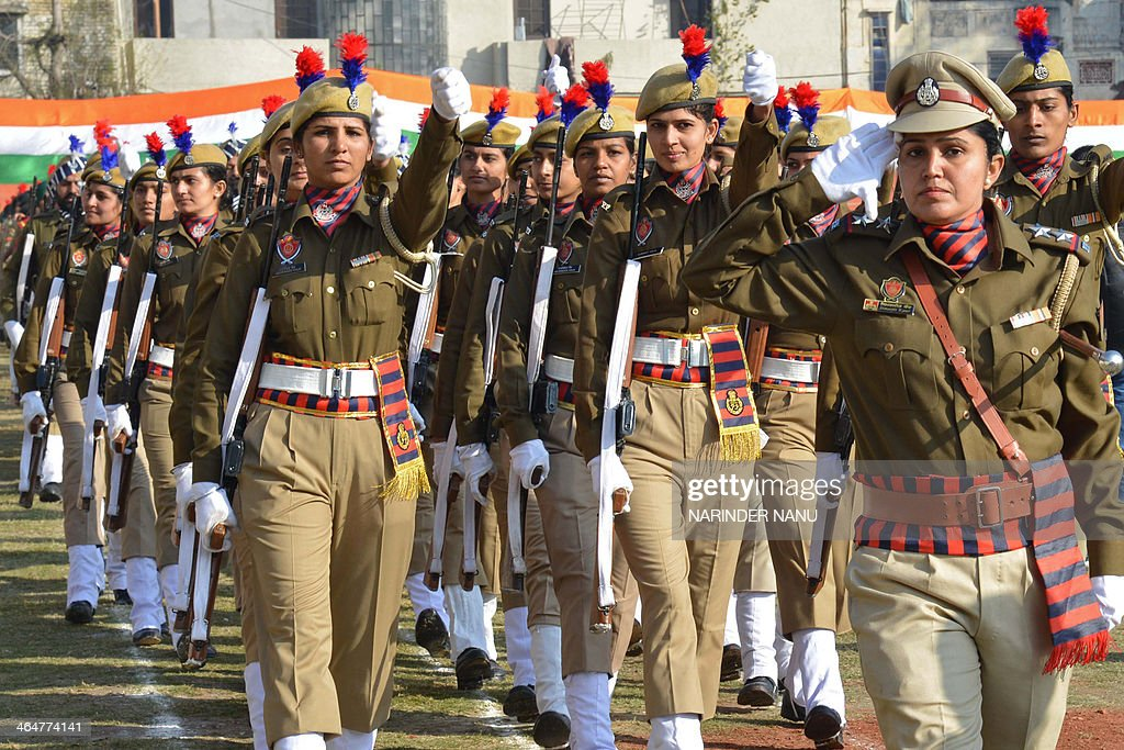 Indian Punjab state police personnel participate in a rehearsal for the upcoming 65th Republic Day parade in Amritsar on January 24 2014 India will...