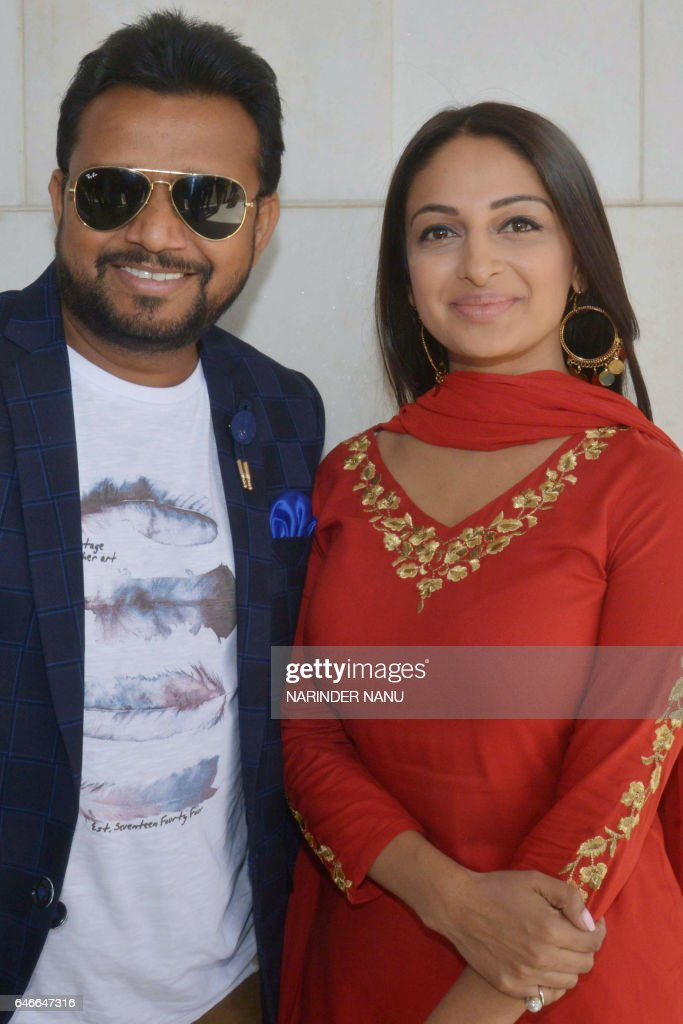 Indian Punjabi actor Karmjit Anmol and actress Rubina Bajwa pose during a promotional event for the upcoming Punjabi film `Sargi` in Amritsar on...