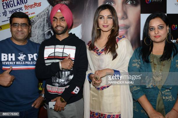 Indian Punjabi actors Ammy Virk and actress Monica Gill pose during a promotional event for the upcoming Punjabi film 'Sat Shri Akaal England' at an...