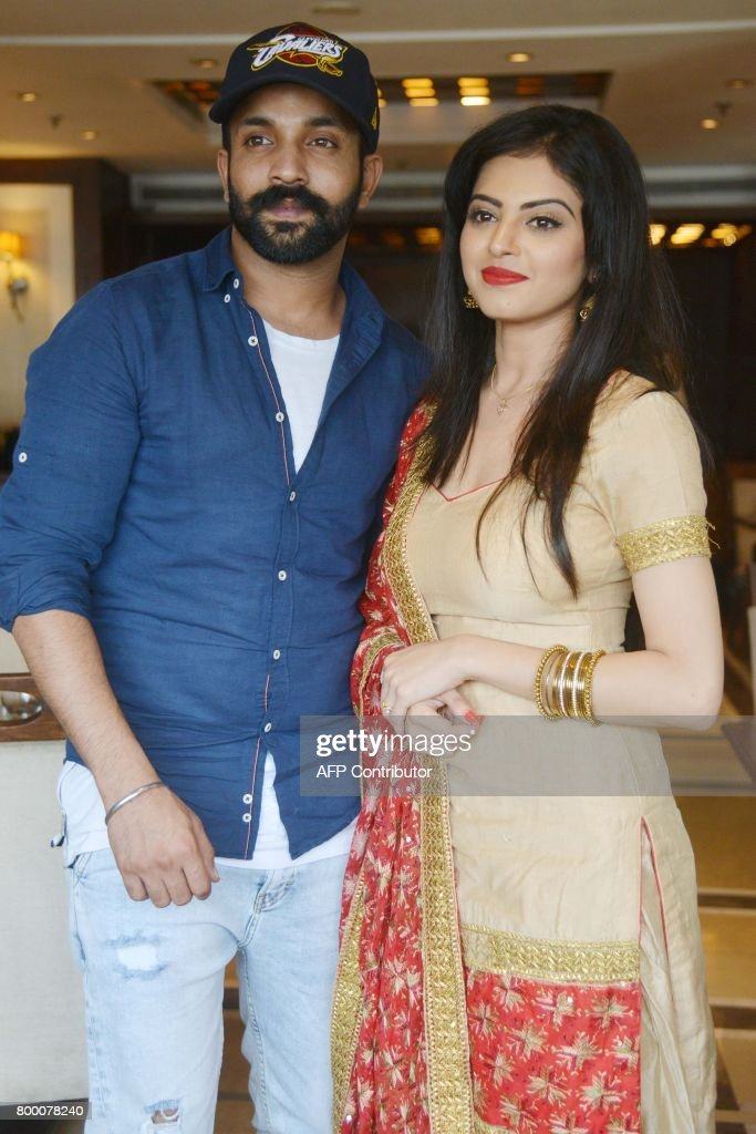 Indian Punjabi actors Dilpreet Dhillon and Roshni Sahota pose for a picture during a promotional event for the upcoming Punjabi film `Great Sardaar`..