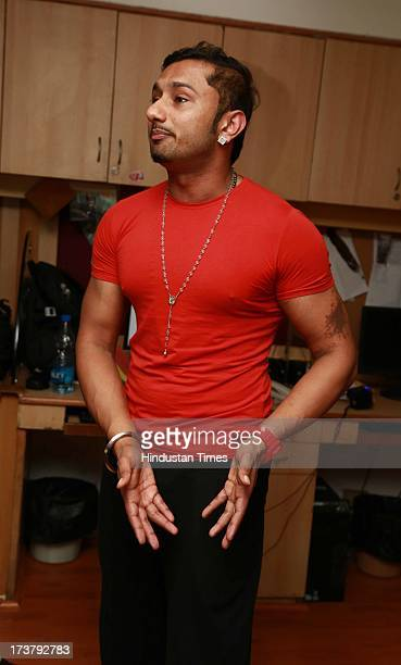 Indian Punjabi and Bollywood singer Honey Singh poses for the camera during an exclusive profile shoot at HT Media office on July 9 2013 in New Delhi...