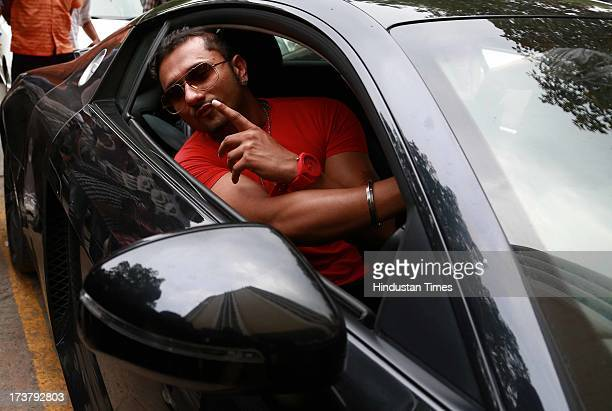 Indian Punjabi and Bollywood singer Honey Singh poses for the camera during an exclusive profile shoot at HT Media office on July 9, 2013 in New...
