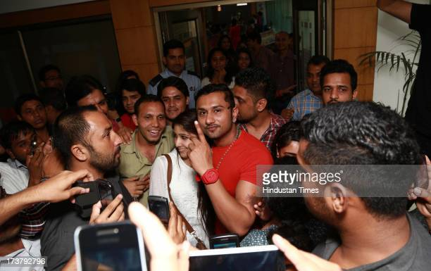 Indian Punjabi and Bollywood singer Honey Singh with his fans at HT Media office on July 9 2013 in New Delhi India Honey Singh has received the ETC...