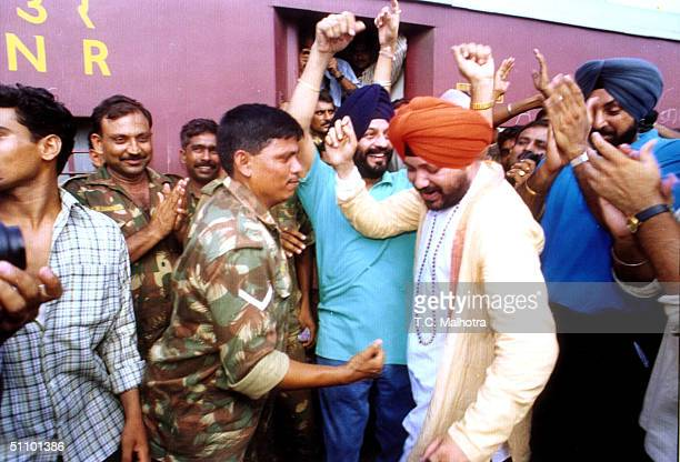 Indian Punjabi Pop Star Daler Mehandi Dances With Indian Army Soldiers At A Railway Station In New Delhi July 61999 Before Their Departure To The...
