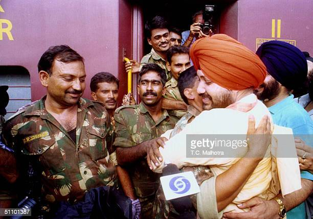 Indian Punjabi Pop Star Daler Mehandi Hugs An Indian Army Soldier At A Railway Station In New Delhi July 6 1999 Before Their Departure To The Kargil...