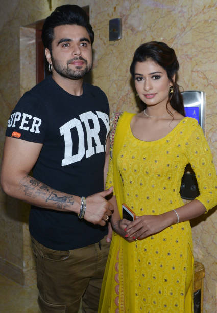 Indian Punjabi singer and actor Ninja and actress Payal Rajput pose for a photograph during a promotional event for the forthcoming Punjabi film...