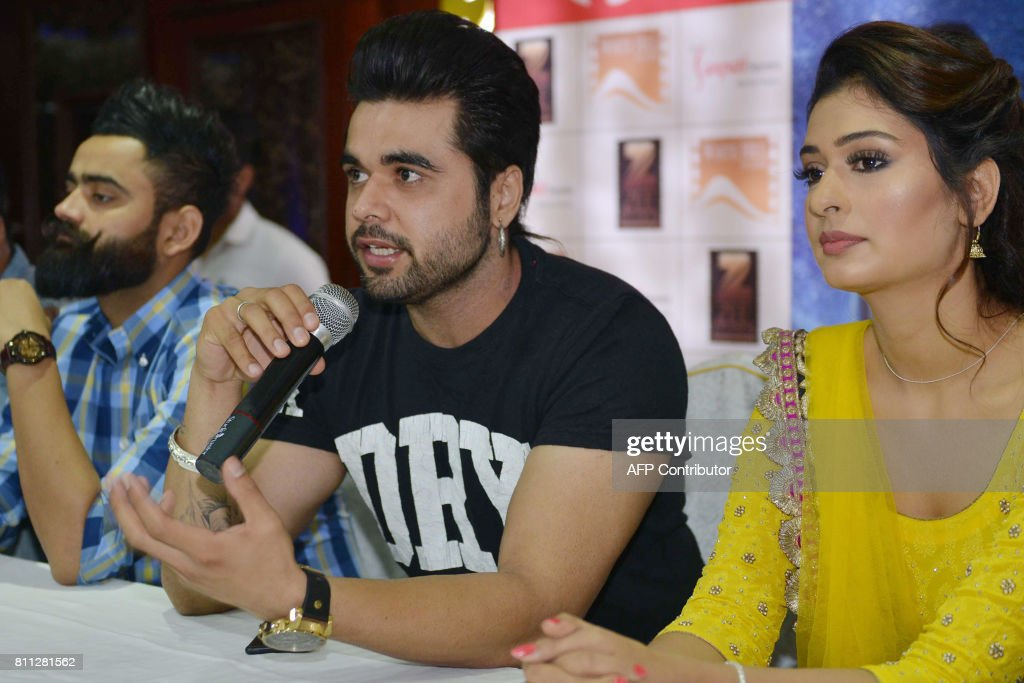 Indian Punjabi singer and actor Ninja and actress Payal Rajput speak to media during a promotional event for the forthcoming Punjabi film `Channa...