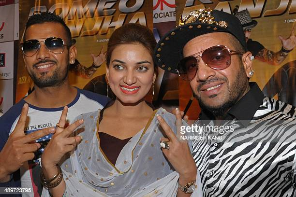 Indian Punjabi singer Garry Sandhu and Jazzy B pose with actress Aman Grewal during a promotional event in Amritsar on May 12 2014 AFP PHOTO/...