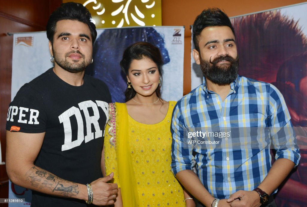 Indian Punjabi singers and actors Ninja and Amrit Maan and actress Payal Rajput pose for a photograph during a promotional event for the forthcoming..