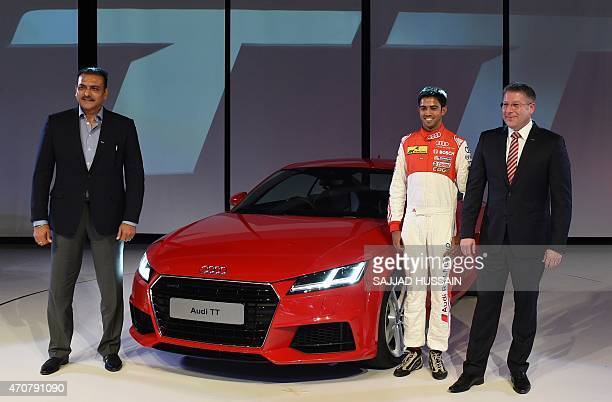 Indian racing driver Aditya Patel India Audi Head Joe King and former Indian cricketer Ravi Shastri pose for a photograph alongside the newlylaunched...