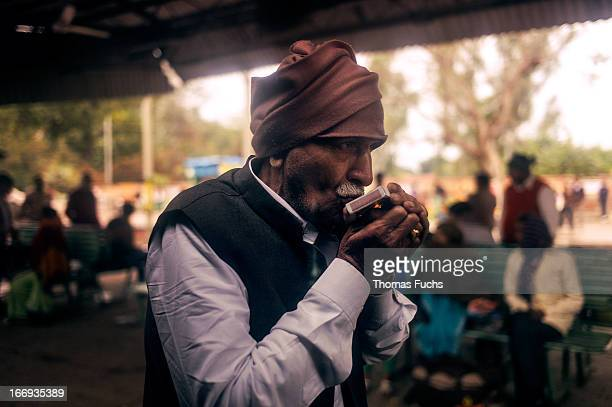 CONTENT] Indian rail ticket inspector lighting a fag during a planned stop on the DelhiVaranasi Express at Lucknow station