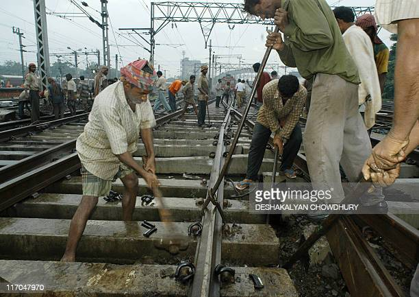 Indian railway engineers make changes in the signaling system at Howrah Station the main railway terminus of Calcutta 12 September 2003 The Howrah...