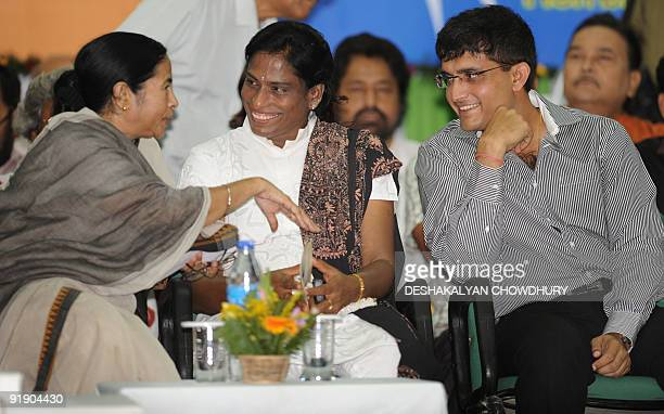Indian Railway Minister Mamata Banerjee speaks with former Indian Olympian PT Usha and Cricket captain Sourav Ganguly during an event in Kolkata on...