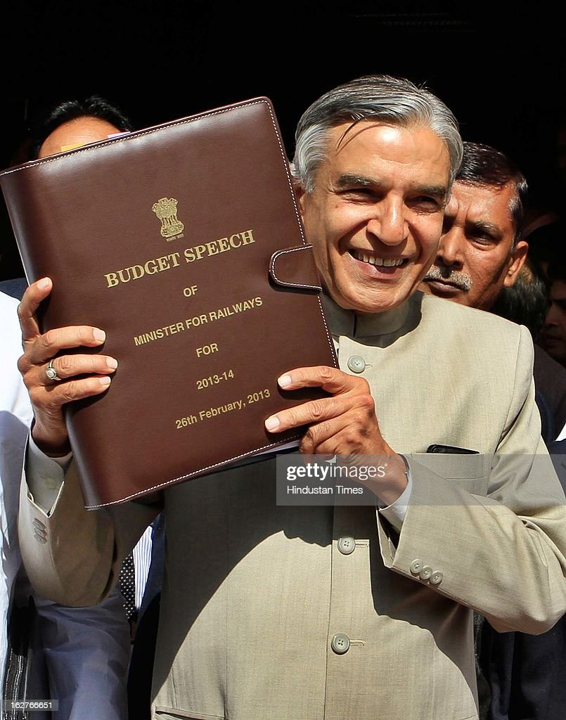 Indian Railway Minister Pawan Kumar Bansal holds up his Budget Speech as he walks towards Parliament to present the Indian Railway budget 2013-14, on February 26, 2013 in New Delhi, India.