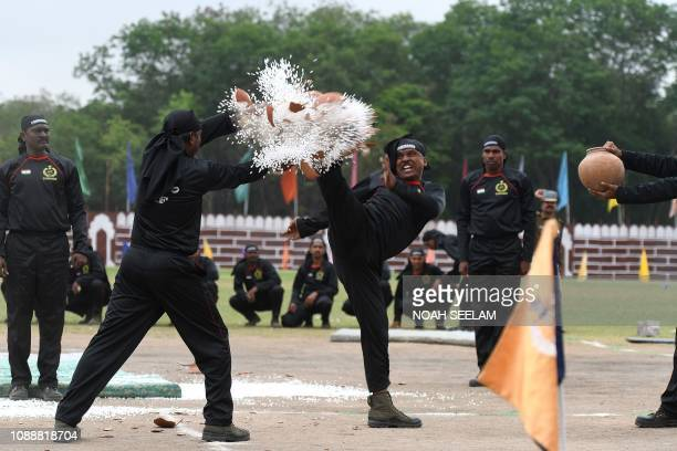 Indian Railway Protection Force commandoes perform stunts during Republic Day celebrations in Secunderabad the twin city of Hyderabad on January 26...