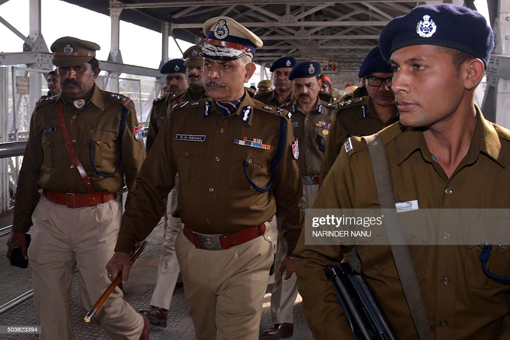Indian Railway Protection Force Director General Rajiva Ranjan Verma walks with RPF officials as they inspect security at the railway station in...