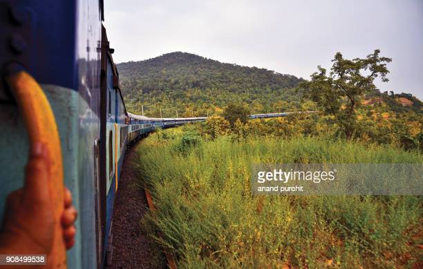 indian railway, train passing through mountains and forest area, madhya pradesh, india - madhya pradesh stock pictures, royalty-free photos & images