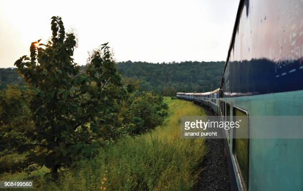 indian railway, train passing through mountains and forest area, madhya pradesh, india - madhya pradesh stock photos and pictures