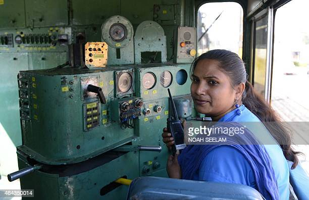 Indian Railways locomotive driver Lakshmi Devi talks on a radio inside a train at a railway station in Secunderabad the twin city of Hyderabad on...