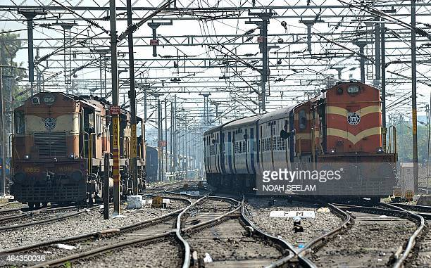 Indian Railways trains arrive on platforms at a railway station in Secunderabad the twin city of Hyderabad on February 25 2015 Indian Railways...