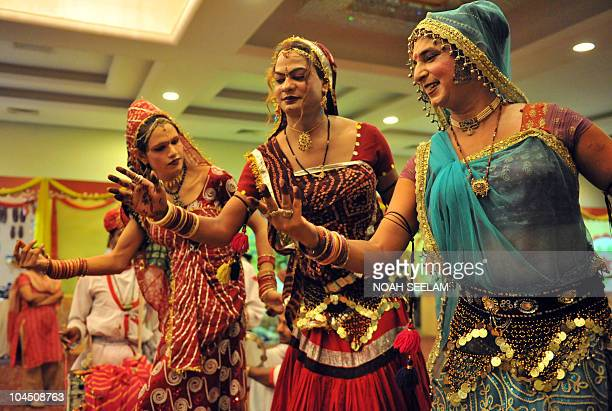 Indian Rajasthan male dancers traditionally dressed as women perform the 'Dhola Maru' folk dance in Hyderabad on September 28 2010 during 'Rajasthan...