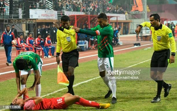 Indian referee Rahul Kumar Gupta gives a red card to Bangladesh captain and midfielder Jamal Bhuyan during the football match between Nepal and...