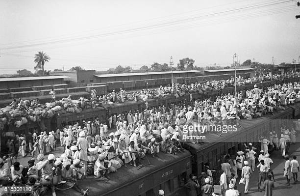 Indian refugees crowd onto to trains as a result of the creation of two independent states India and Pakistan Muslims flee to Pakistan and Hindus...