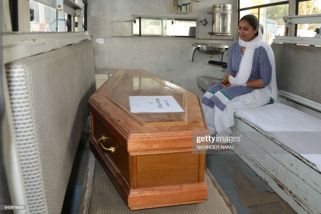 TOPSHOT Indian relative Gurpinder Kaur cries near the coffin of her brother Manjinder Singh who was killed in Iraq at the International Airport in...