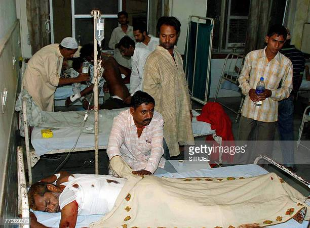 Indian relatives and medical personnel take care of injured bomb blast victims at The JLN Hospital in Ajmer 11 October 2007 At least one person was...