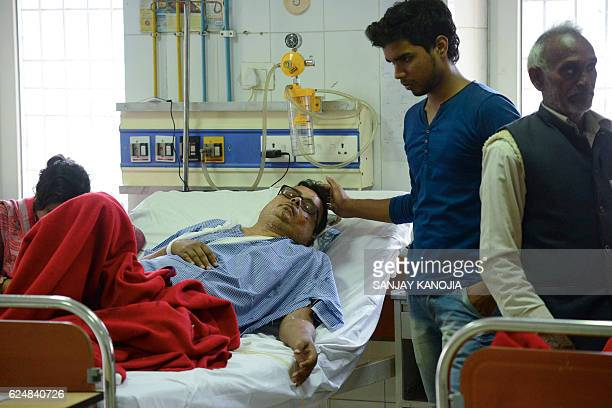 Indian relatives assist an injured train passenger at a hospital in Kanpur on November 21 2016 Rescuers on November 21 ended their search for...