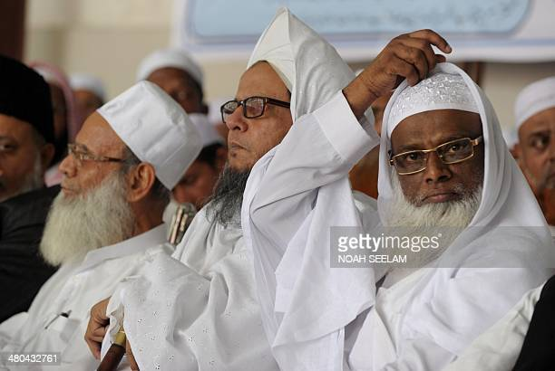 Indian representatives from various Islamic organisations take part in a protest meeting following the arrest of citybased Islamic theologian Maulana...