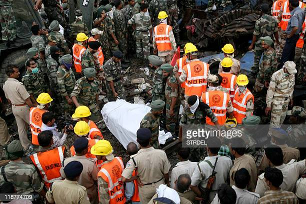 Indian rescue personnel use a stretcher to carry a body from the scene of a rail accident at Fatehpur on July 11 2011 Rescue teams pulled bodies and...