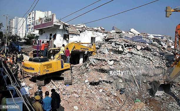 Indian rescue workers dig through the rubble of a collapsed building in Hyderabad on December 9 2016 Three bodies were recovered as between 10 to 12...