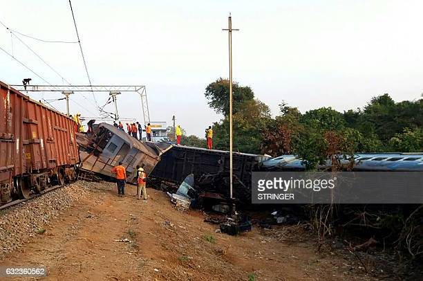 Indian rescue workers look for survivors at the site of the derailment of the JagdalpurBhubaneswar express train near Kuneru station in southern...