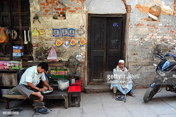 Indian resident Bashir Ahmed sits outside his house one day after the Indian general election results were announced in Varanasi on May 17 2014...