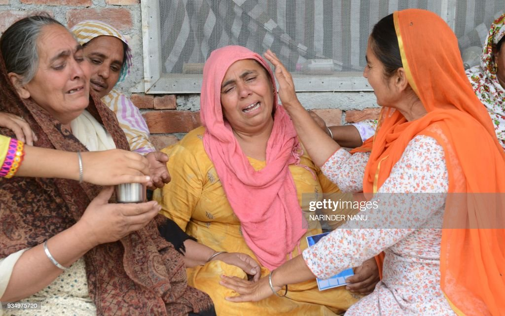Indian resident Ranjit Kaur and relatives react to confirmation of the death of her son Jatinder Singh in the village of Sialka some 35 kms from...