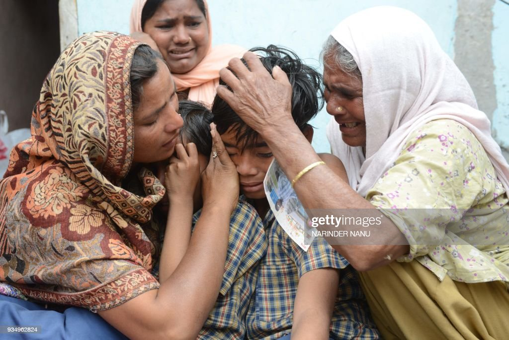 Indian resident Seema her sons Karan and Arjun and her mother inlaw Jeeto react following confirmation by External Affairs minister Sushma Swaraj...