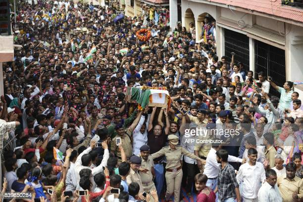 Indian residents carry the coffin of the CRPF soldier Dinesh Dipakbhai Borse killed in an attack by militants in Kashmir during his funeral...