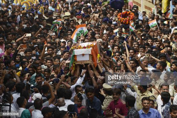 TOPSHOT Indian residents carry the coffin of the CRPF soldier Dinesh Dipakbhai Borse killed in an attack by militants in Kashmir during his funeral...