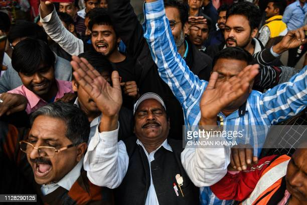Indian residents dance and shout slogans at a central market in New Delhi on March 1 as they wait for the return of an Indian Air Force pilot being...