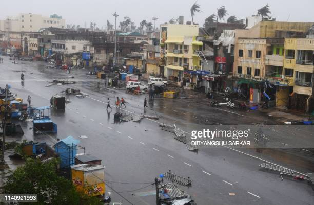 Indian residents inspect damages on a street after Cyclone Fani landfall in Puri in the eastern Indian state of Odisha on May 3 2019 Two people died...