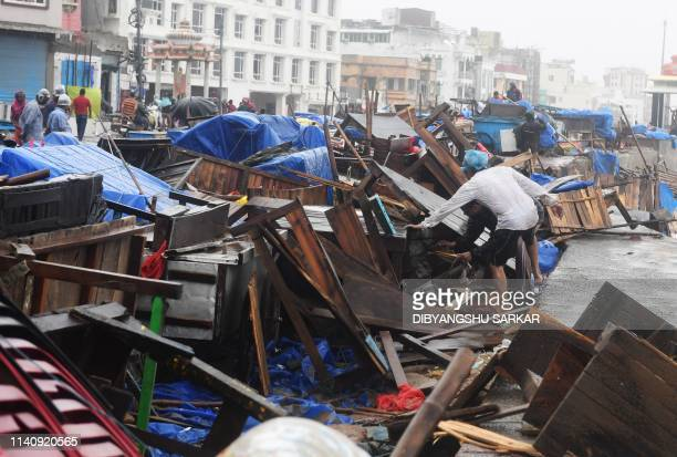 Indian residents inspect damages on street stalls at a promenade after Cyclone Fani landfall in Puri in the eastern Indian state of Odisha on May 3...