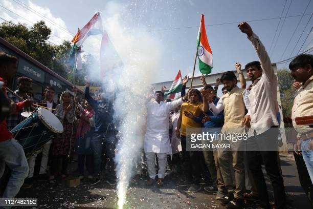 Indian residents let off fireworks to celebrate the Indian Air Force strike launched on a JaisheMohammad camp at Balakot in Bhopal in the Madhya...