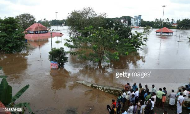 Indian residents look at the Shiva Temple submerged after the release of water from Idamalayar dam following heavy rains in Kochi on August 9 2018 At...