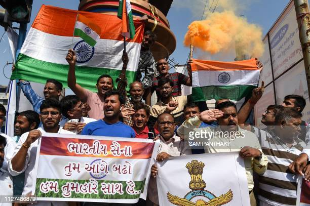 Indian residents participate in a demonstration to support Indian armed forces in Ahmedabad on February 26 following an Indian Air Force strike...