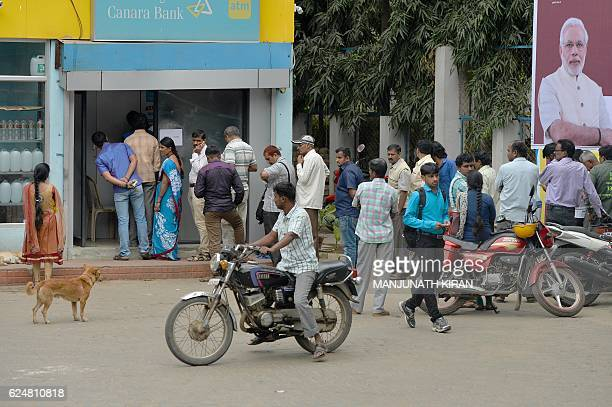 Indian residents queue near an ATM counter at an Indian bank to try to withdraw money in Bangalore on November 21 2016 Frustration is mounting in...